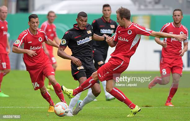 Collin Quaner of 1 FC Union Berlin and Tobias Haitz of FC Viktoria Koeln during the DFB Cup match between FC Viktoria Koeln and Union Berlin at...