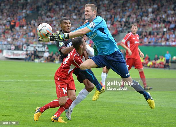 Collin Quaner of 1 FC Union Berlin Roberto Guirino and NicoStephano Pellatz of FC Viktoria Koeln during the DFB Cup match between FC Viktoria Koeln...