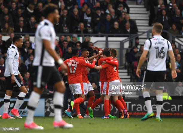 Collin Quaner of Huddersfield Town celebrates scoring the opening goal with team mates during the Sky Bet Championship match between Derby County and...