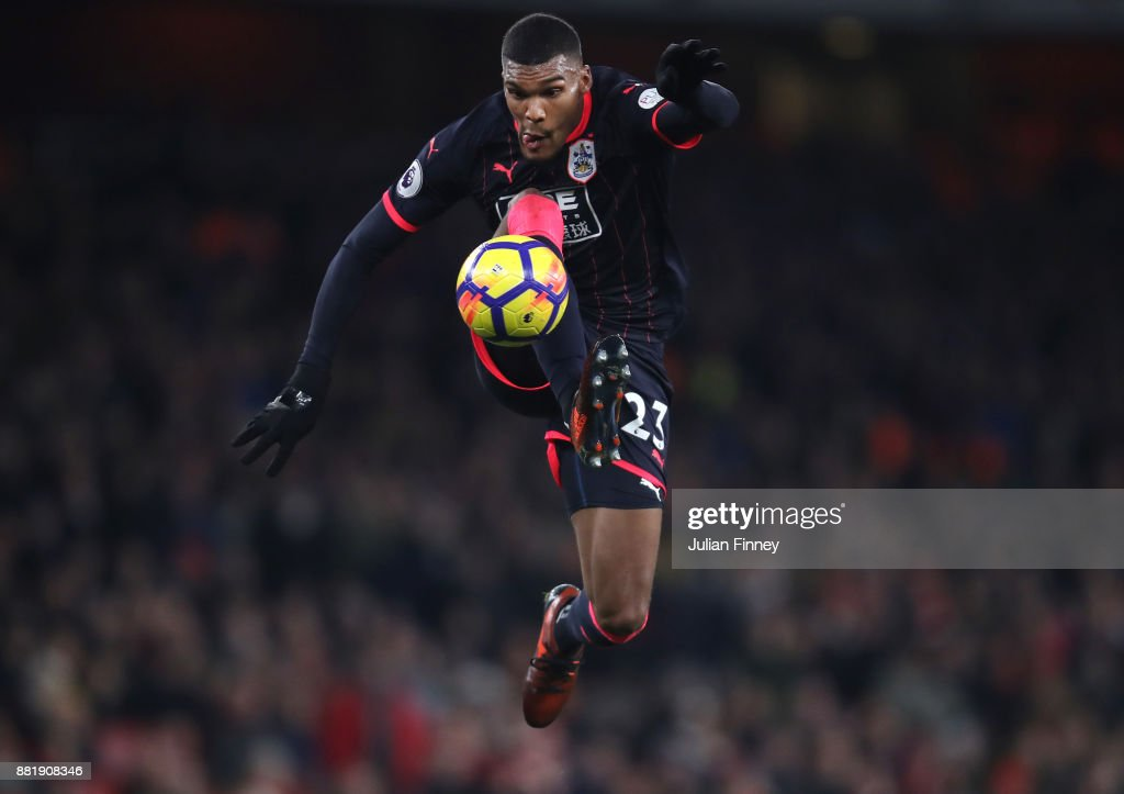Collin Quaner of Huddersfield Town controls the ball in mid air during the Premier League match between Arsenal and Huddersfield Town at Emirates Stadium on November 29, 2017 in London, England.