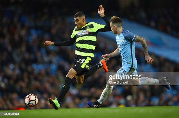 Collin Quaner of Huddersfield Town takes on Aleix Garcia of Manchester City during The Emirates FA Cup Fifth Round Replay match between Manchester...