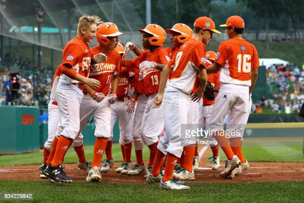 Collin Ross of the Southwest team from Texas is mobbed by his teammates after hitting a home run during Game 4 of the 2017 Little League World Series...