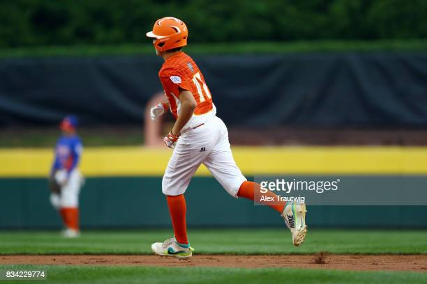 Collin Ross of the Southwest team from Texas rounds the bases after hitting a home run during Game 4 of the 2017 Little League World Series against...