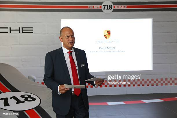 Collin Sattar Brand Manager at Porsche Centre Bahrain presents the Porsche's new model of cars 718 Boxster and 718 Boxster S during the launch at...