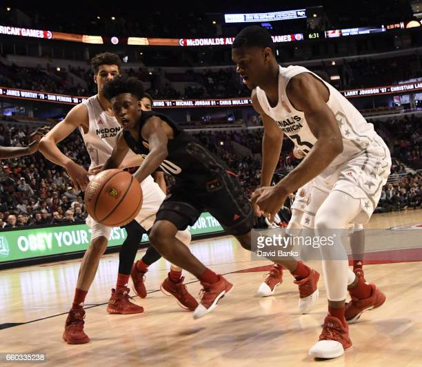 Collin Sexton boys east team and Billy Preston boys west team go for the ball during the 2017 McDonalds's All American Game on March 29 2017 at the...