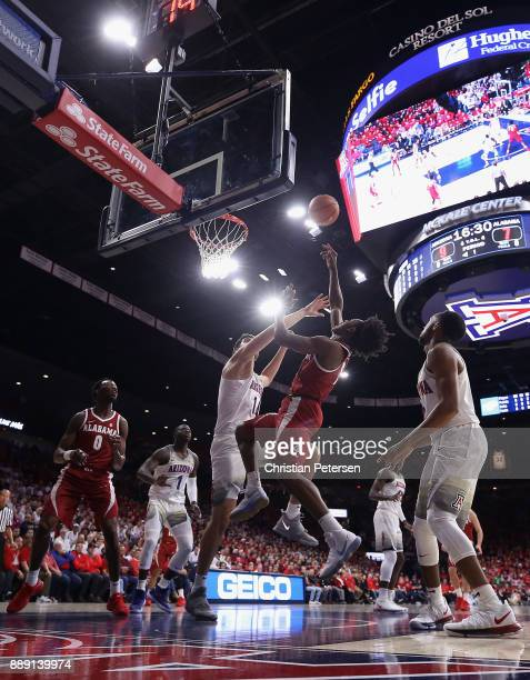 Collin Sexton of the Alabama Crimson Tide attempts a shot over Dusan Ristic of the Arizona Wildcats during the first half of the college basketball...