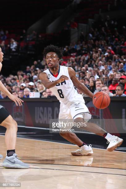 Collin Sexton of the USA Junior Select Team drives against the World Select Team during the game on April 7 2017 at the MODA Center Arena in Portland...
