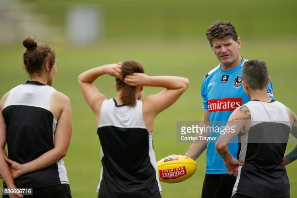 Collingwood assistant coach Robert Harvey takes the AFLW team through some drills during a Collingwood Magpies men's and women's joint AFL preseason...