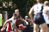 Collingwood assistant coach Scott Burns looks on during a Melbourne Demons AFL training session at Gosch's Paddock on February 7 2014 in Melbourne...