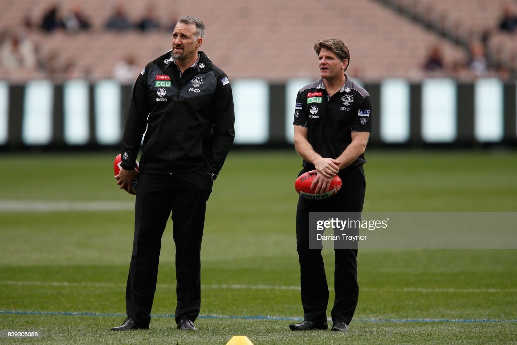Collingwood assistant coachs Anthony Rocca and Robert Harvey look on before the round 23 AFL match between the Collingwood Magpies and the Melbourne Demons at Melbourne Cricket Ground on August 26, 2017 in Melbourne, Australia.