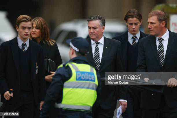Collingwood Magies President Eddie Maguire arrives with wife Carla and his sons at the Lou Richards State Funeral Service at St Paul's Cathedral on...