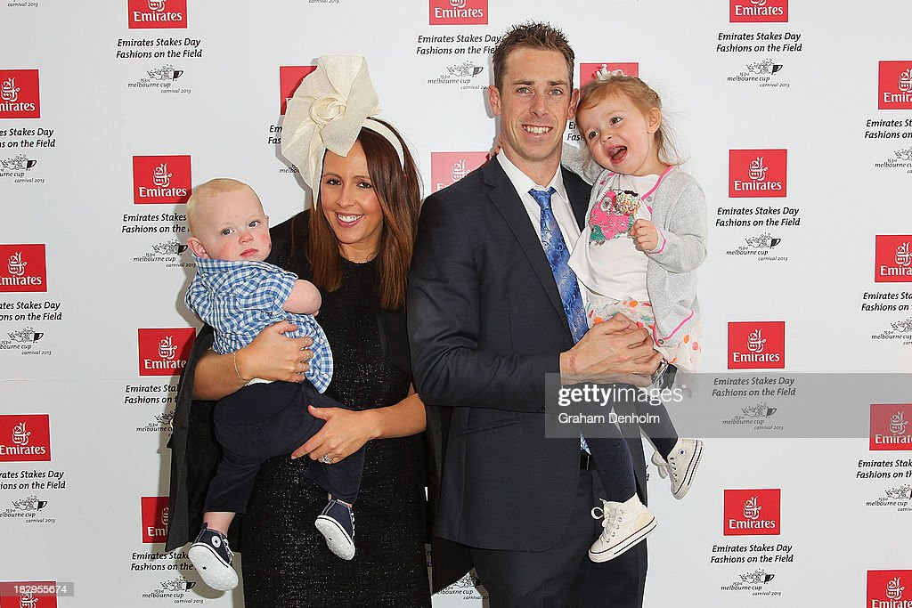 Collingwood Magpies Captain <a gi-track='captionPersonalityLinkClicked' href=/galleries/search?phrase=Nick+Maxwell&family=editorial&specificpeople=596853 ng-click='$event.stopPropagation()'>Nick Maxwell</a> poses with his wife Erin Maxwell and their two children at the Emirates Stakes Day Fashion on the Field Launch at Flemington Racecourse on October 3, 2013 in Melbourne, Australia.