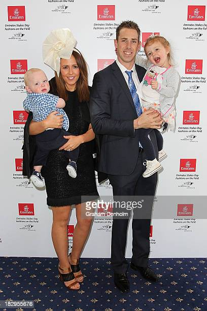 Collingwood Magpies Captain Nick Maxwell poses with his wife Erin Maxwell and their two children at the Emirates Stakes Day Fashion on the Field...
