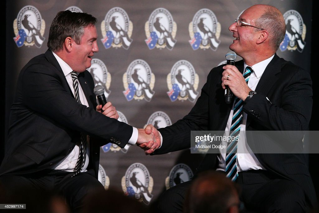 Collingwood Magpies President Eddie McGuire and Port Adelaide President David Koch shake hands at The Importance of Leadership Business Networking...