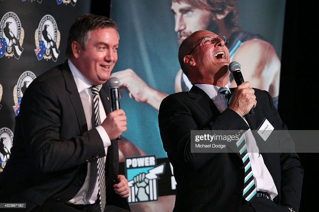 Collingwood Magpies President Eddie McGuire and Port Adelaide President David Koch react when speaking at The Importance of Leadership Business...
