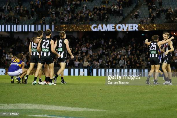 Collingwood players celebrates after the round 18 AFL match between the Collingwood Magpies and the West Coast Eagles at Etihad Stadium on July 23...