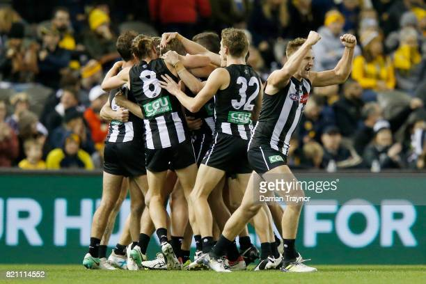 Collingwood players celebrates the final goal during the round 18 AFL match between the Collingwood Magpies and the West Coast Eagles at Etihad...