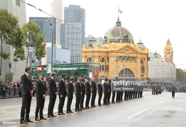 Collingwood players form a guard of honour as the coffin of Lou Richards leaves the Service in a hearse at the Lou Richards State Funeral Service at...