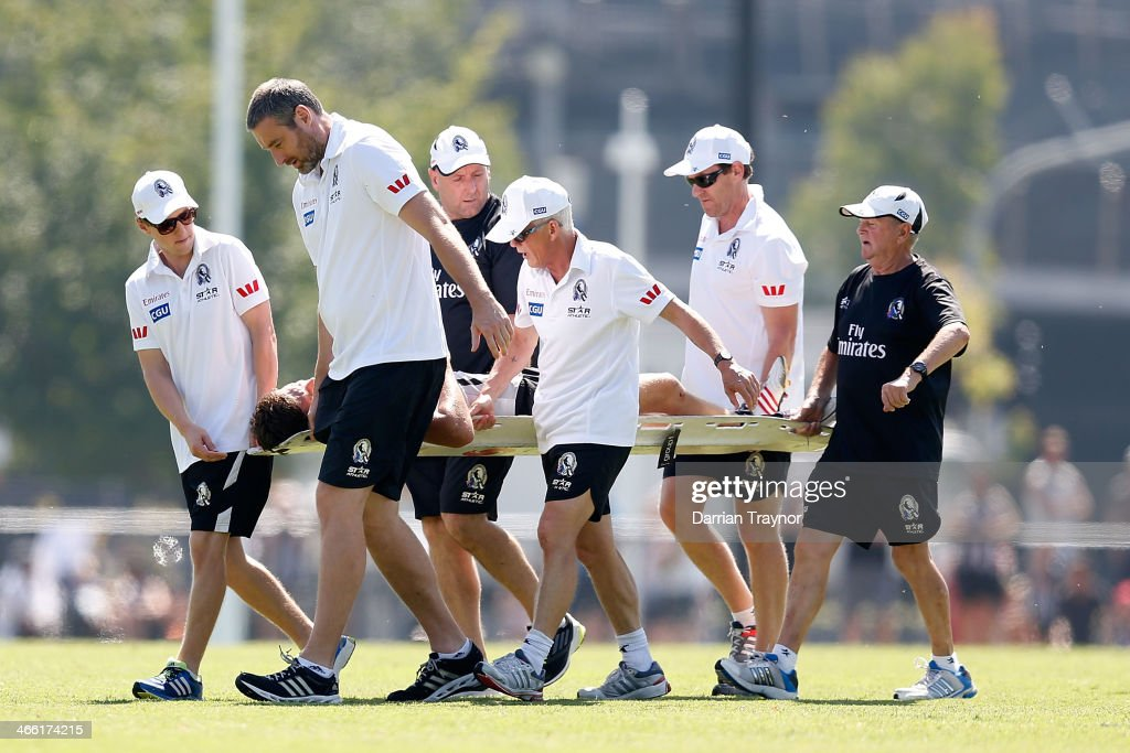 Collingwood staff stretcher off injured player Adam Oxley during a Collingwood Magpies AFL pre-season intra-club match at Olympic Park on February 1, 2014 in Melbourne, Australia.