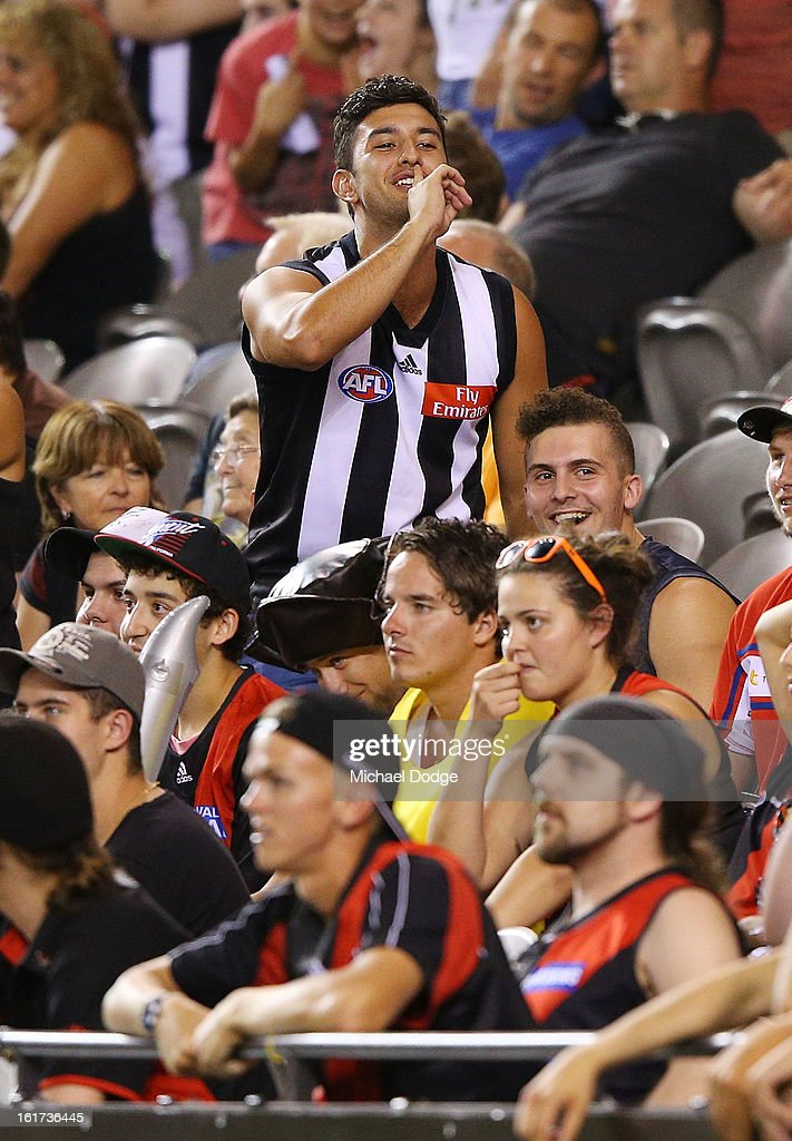 A Collingwood supporter reacts after a goal during the round one AFL NAB Cup match between the Collingwood Magpies and the Essendon Bombers at Etihad Stadium on February 15, 2013 in Melbourne, Australia.