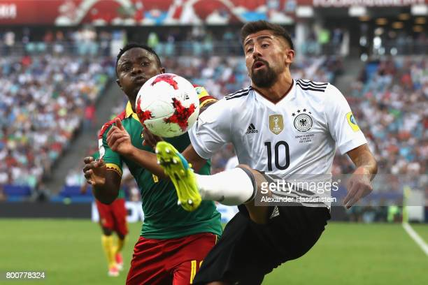 Collins Fai of Cameroon and Kerem Demirbay of Germany battle for possession during the FIFA Confederations Cup Russia 2017 Group B match between...