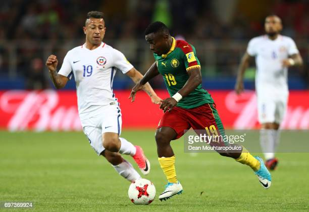 Collins Fai of Cameroon attempts to get past Leonardo Valencia of Chile during the FIFA Confederations Cup Russia 2017 Group B match between Cameroon...