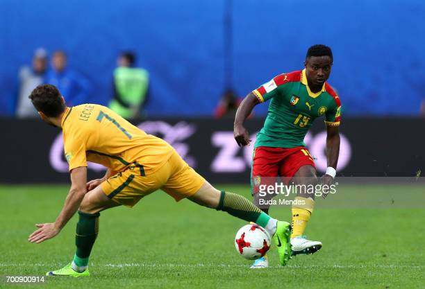 Collins Fai of Cameroon goes past Mathew Leckie of Australia during the FIFA Confederations Cup Russia 2017 Group B match between Cameroon and...