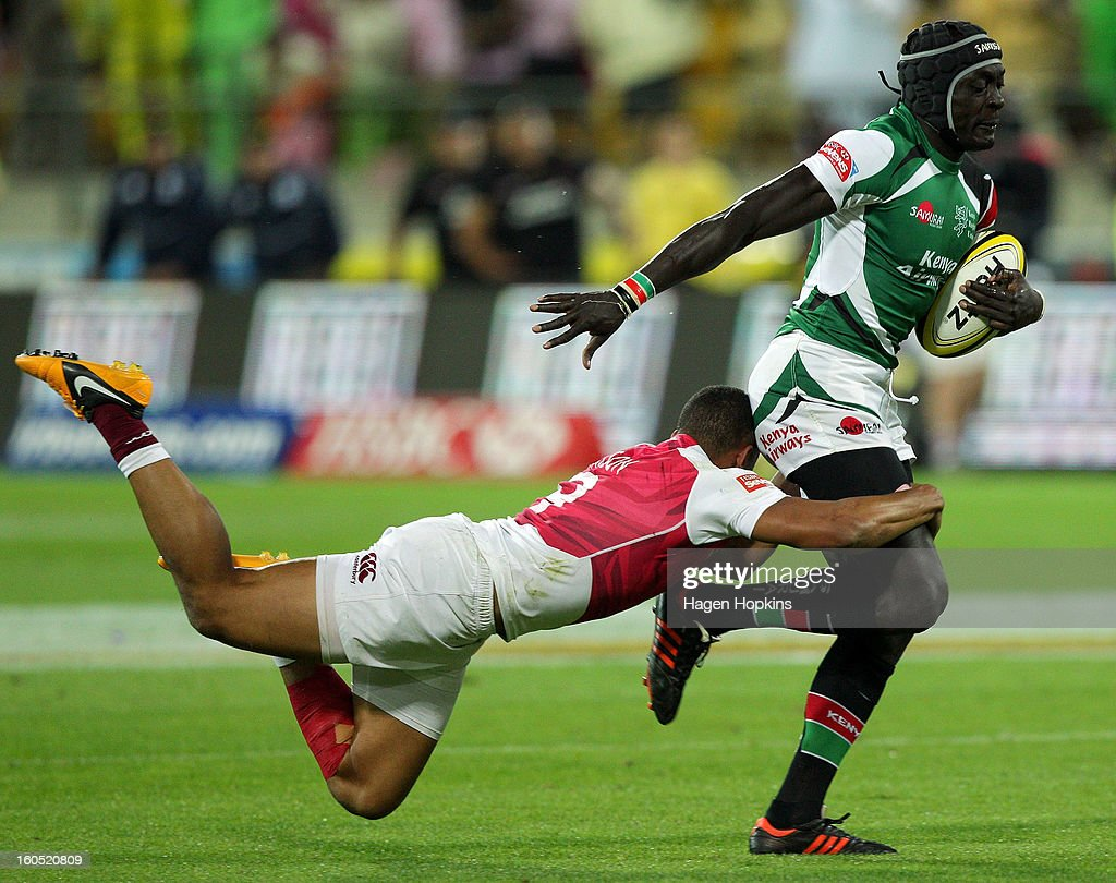 Collins Injera of Kenya is tackled by Marcus Watson of England in the final cup match between England and Kenya during the 2013 Wellington Sevens at Westpac Stadium on February 2, 2013 in Wellington, New Zealand.