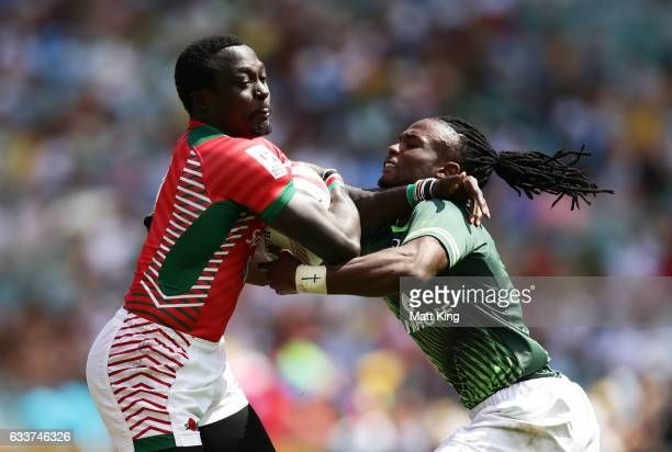 Collins Injera of Kenya is tackled by Seabelo Senatla of South Africa during the mens pool match between South Africa and Kenya in the 2017 HSBC...