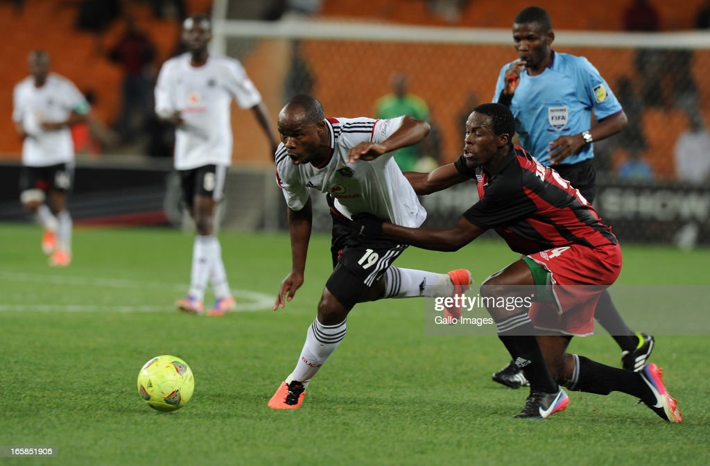 Collins Mbesuma of Orlando pirates battling for the ball with Samson Chilupe of Zanaco FC during the CAF Confedaration Cup match between Orlando Pirates and Zanaco at FNB Stadium on April 06, 2013 in Johannesburg, South Africa.