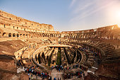 horizontal shot of Colliseum, the greatest monument of Italy in summer day, incidental people visiting it.