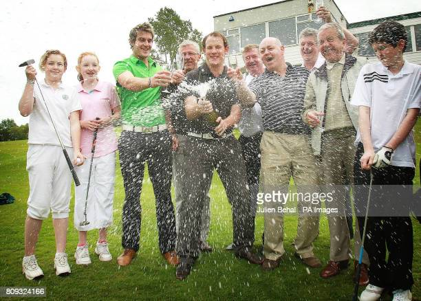 Colm McIlroy Uncle of Rory McIlroy and Stephen Crooks Resident Golf Pro along with members of Hollywood Golf Club in Co Down Northern Ireland as they...