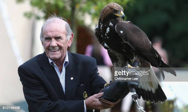 Colm McLoughlin of Dubai Duty Free gets to hold a bird of prey during the Arabian Nights party after Day Two of the Dubai Duty Free Irish Open at...