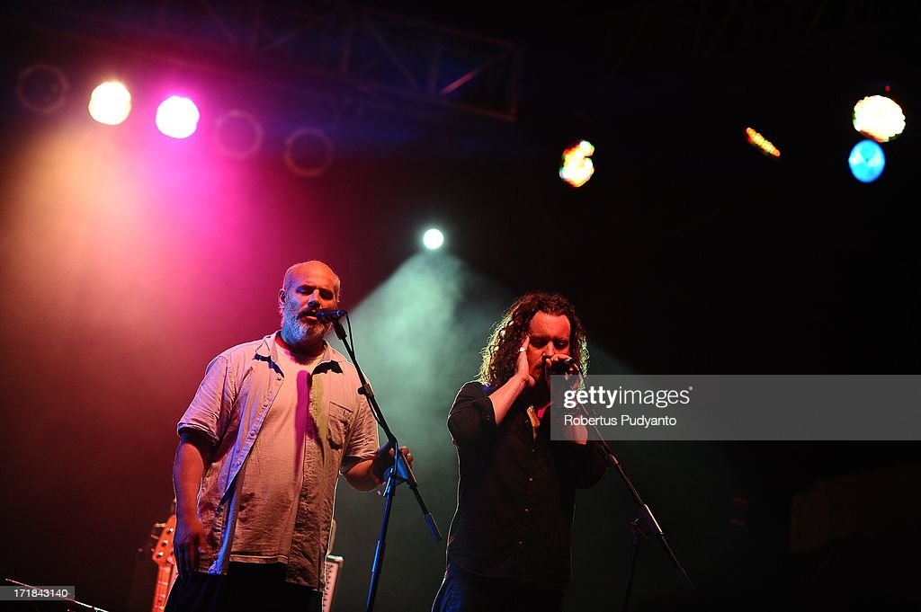 Colm O Snodaigh (L) and Brian Hogan (R) of Kila (Ireland) featuring songs based on gorgeous traditional Irish melodies, percussive like singing and driving rhythms in Rainforest World Music Festival at Sarawak Cultural Village on June 28, 2013 in Kuching, Sarawak, Malaysia.
