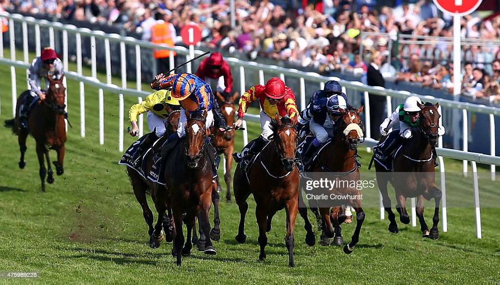 Colm O'Donoghue (Red cap) rides Qualify to win The Investec Oaks at Epsom racecourse on June 05, 2015 in Epsom, England.