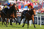 Colm O'Donoghue riding Qualify leads the field to victory in The Investec Oaks races during the Investec Ladies Day at Epsom Racecourse on June 5...