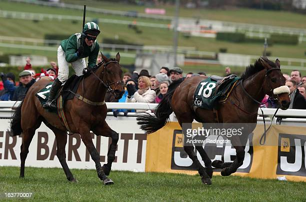 Colm Sweeney celebrates on Salsify after winning the the CGA Foxhunter Chase Challenge Cup on Cheltenham Gold Cup day at Cheltenham Racecourse on...