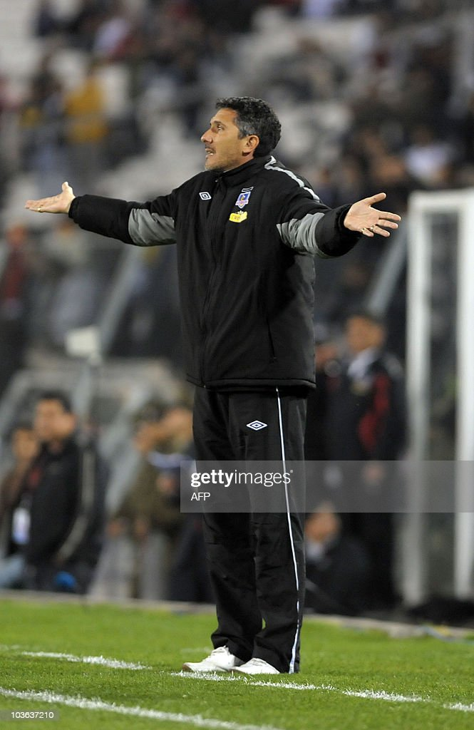 Colo Colo's coach Diego Cagna gestures during their Copa Sudamericana 2010 football match against Universitario de Sucre at Monumental stadium in...