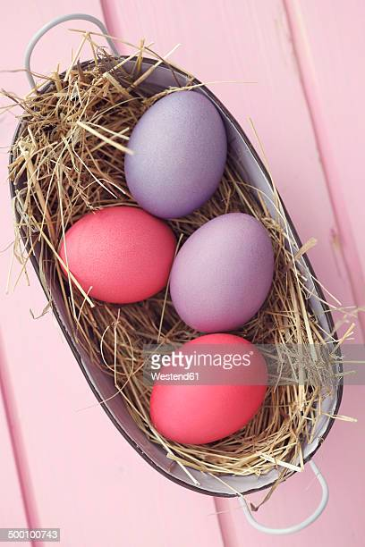 Coloful Easter eggs in basket, studio shot