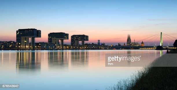 Cologne (Köln) city panorama near Rhine River at blue hour  (North Rhine Westphalia, Germany)