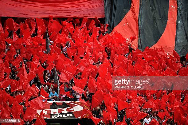 FC Cologne fans cheer for their team during the German first division Bundesliga football match 1 FC Cologne vs Borussia Moenchengladbach in Cologne...