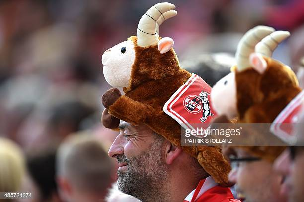 Cologne fans react during the German first division Bundesliga football match 1FC Cologne vs Hamburger SV in Cologne western Germany on August 29...