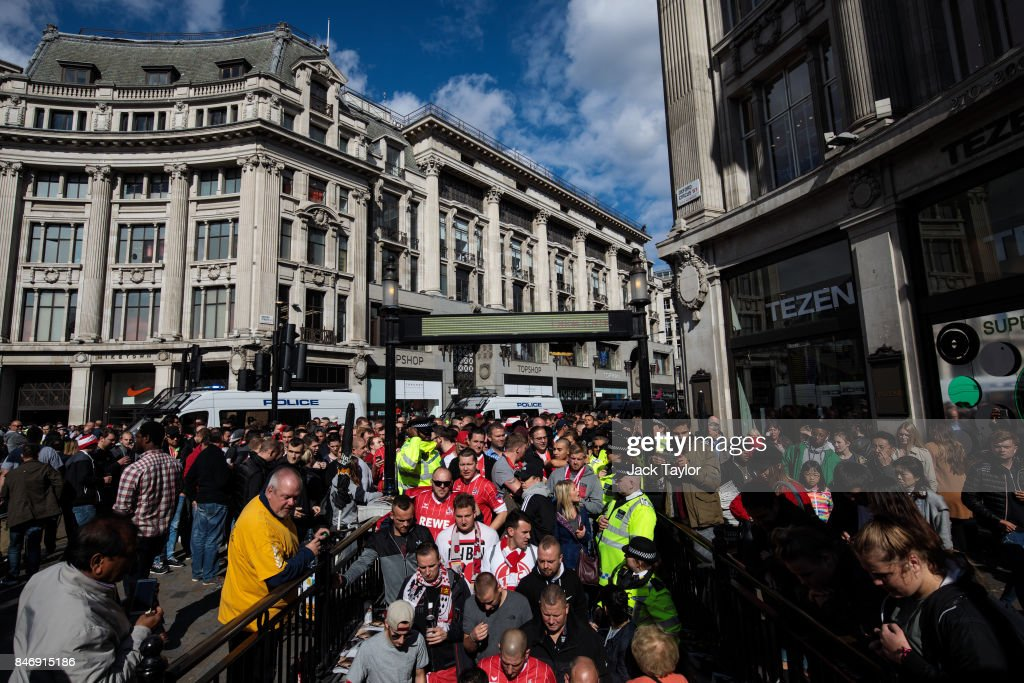 Cologne football fans make their way into Oxford Circus underground station ahead of the FC Koln match against Arsenal this evening on September 14, 2017 in London, England. Arsenal take on FC Koln at the Emirates Stadium as the London team play their first match of the Europa League.