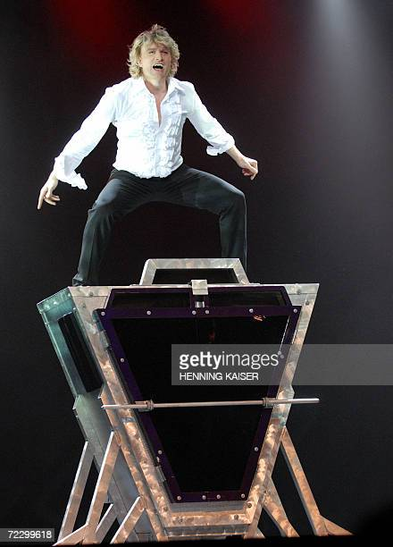 Dutch magician Hans Klok performs a routine during a press preview of his show 'Faster than Magic' in Cologne 30 October 2006 Klok will start his...