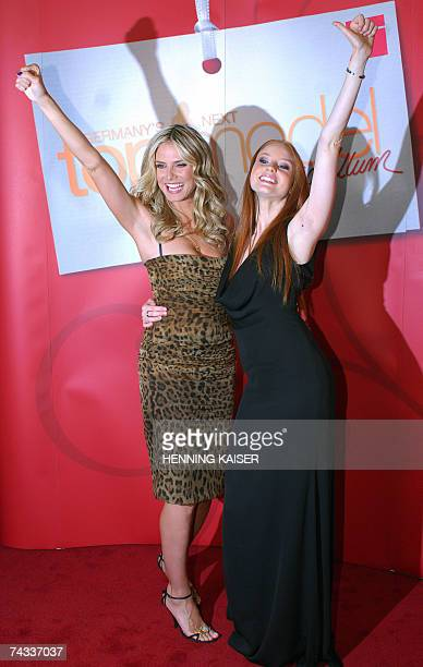 German model Heidi Klum poses for photographers with Barbara the winner of the TV show 'Germany's Next Topmodel' at a press conference in Cologne...