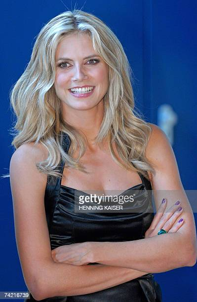 Germany model Heidi Klum poses for photographers at a press conference in Cologne western Germany 22 May 2007 Klum presented the three remaining...