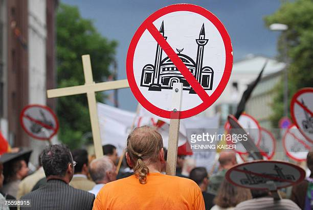 TO GO WITH AFP STORY by YANNICK PASQUET FILES Members of the rightwing organization Pro Cologne protest against the plans to build a new Mosque in...