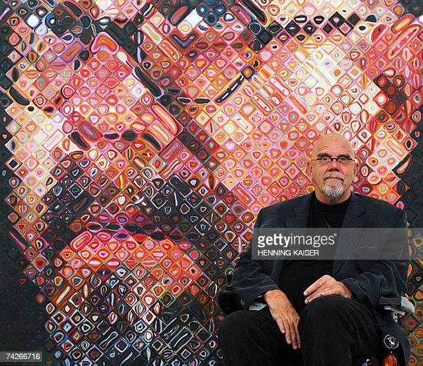 US artist Chuck Close sits in front of one of his paintings a self Portrait 24 May 2007 on show at the exhibition 'Chuck Close returned looks...