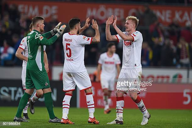 Cologne players react after the German first division Bundesliga football match 1 FC Cologne vs Borussia Dortmund in Cologne western Germany on...