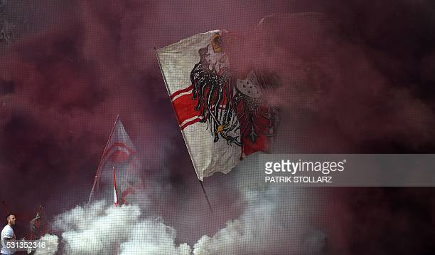 Cologne supporters burn fireworks during the German first division Bundesliga football match between Borussia Dortmund and 1 FC Cologne in Dortmund...